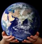 Earth held in a child's hands